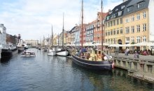 Enjoy historical Nyhavn with cosy restaurants and cafes